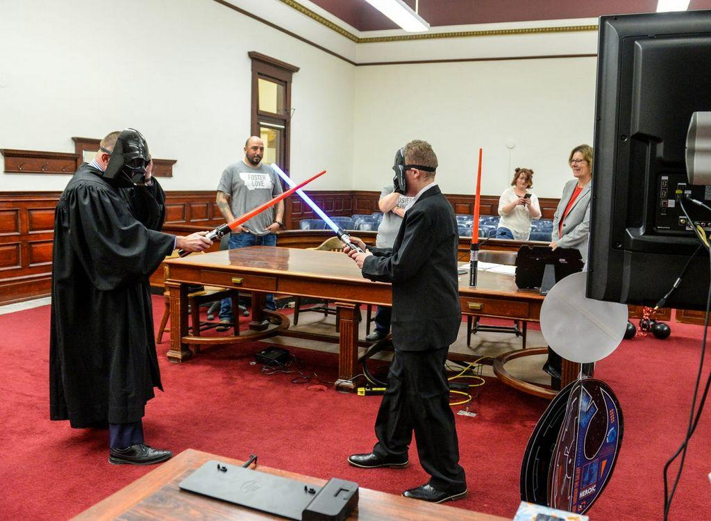 coronavirus-doesn't-stop-montana-boy's-star-wars-themed-adoption,-complete-with-lightsaber-duel